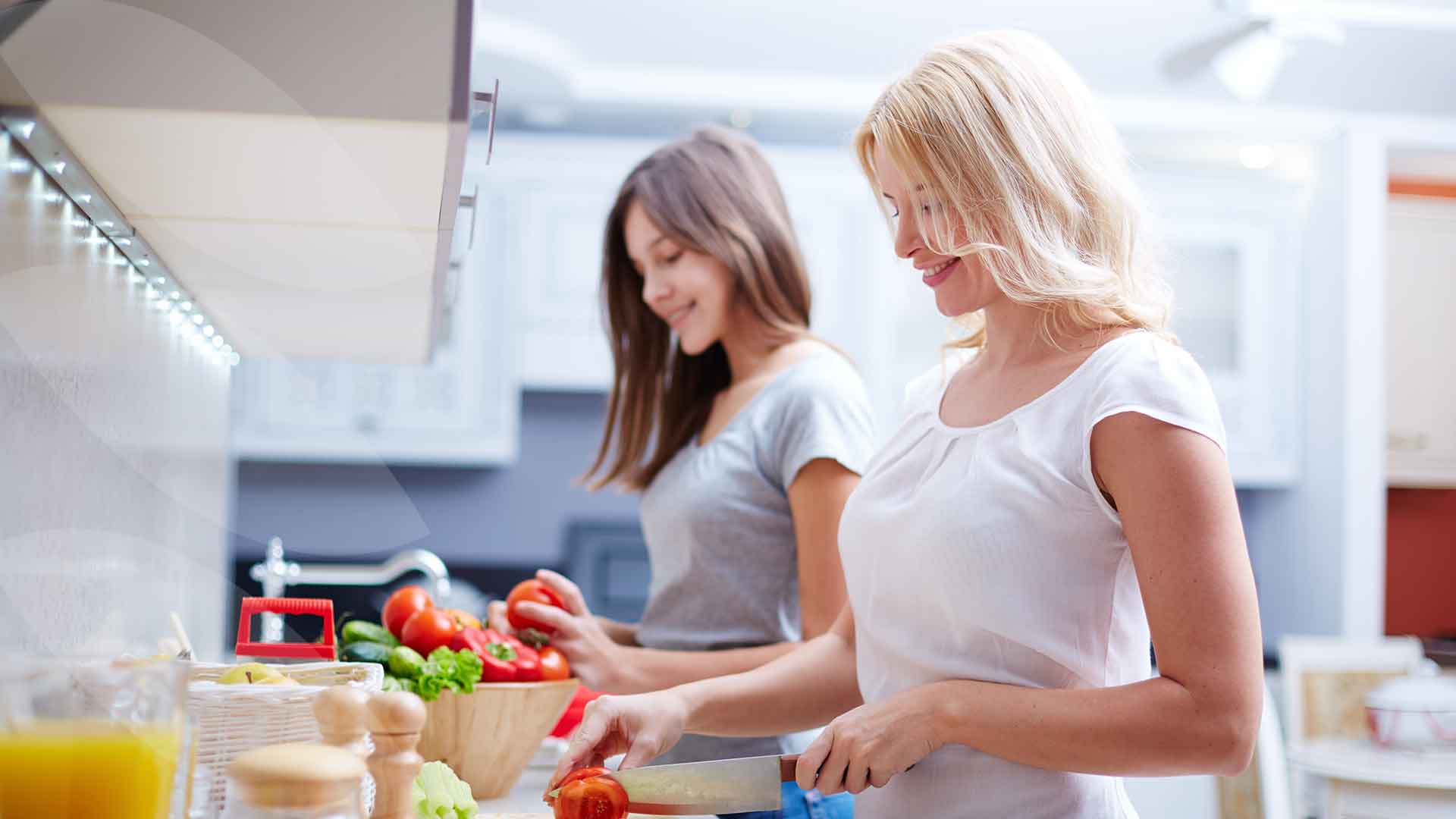 Women preparing healthy food with fresh ingredients